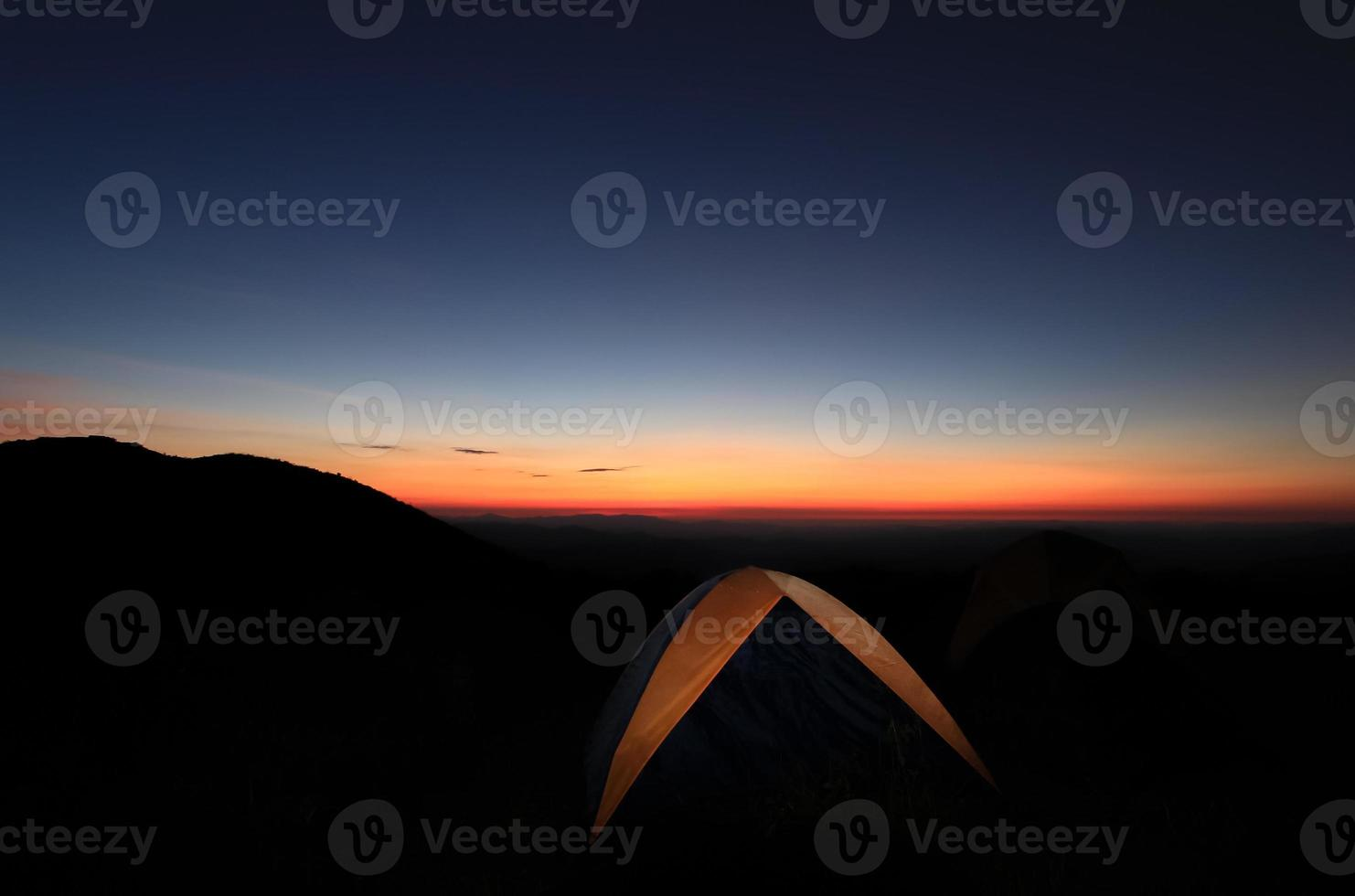 Camping tent at Sunset. photo