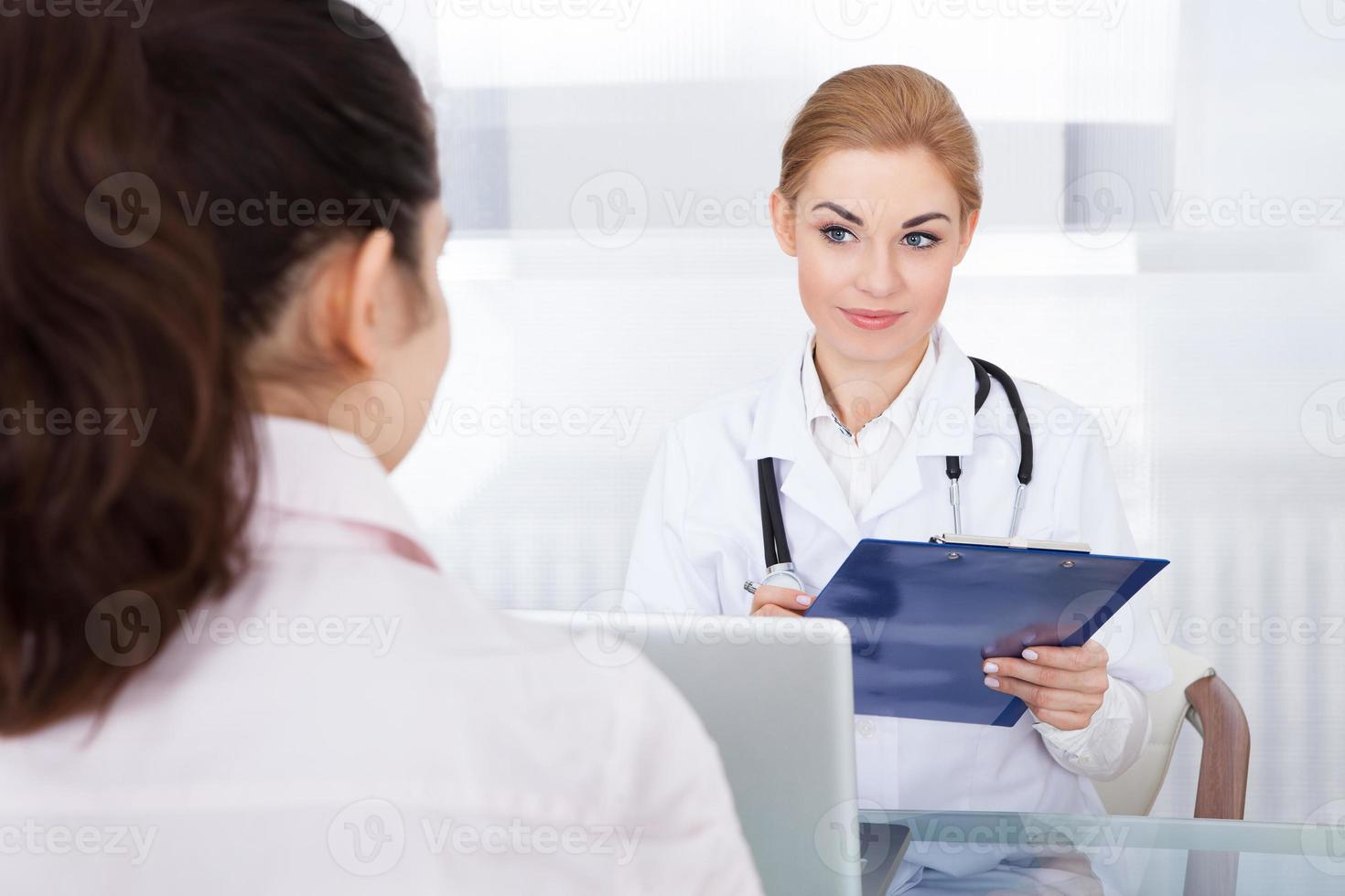 Female Doctor Talking With Patient photo