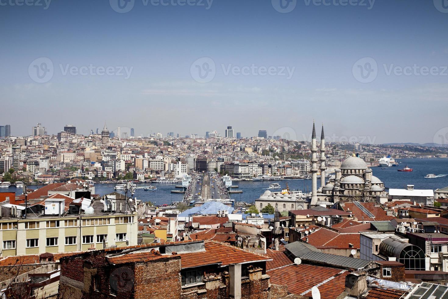Galata Bridge and Yeni (New) Mosque in Istanbul photo