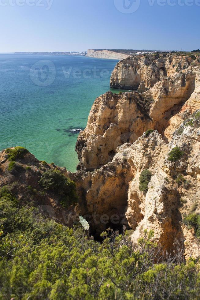 Coast with cliffs in Lagos at Algarve in Portugal photo