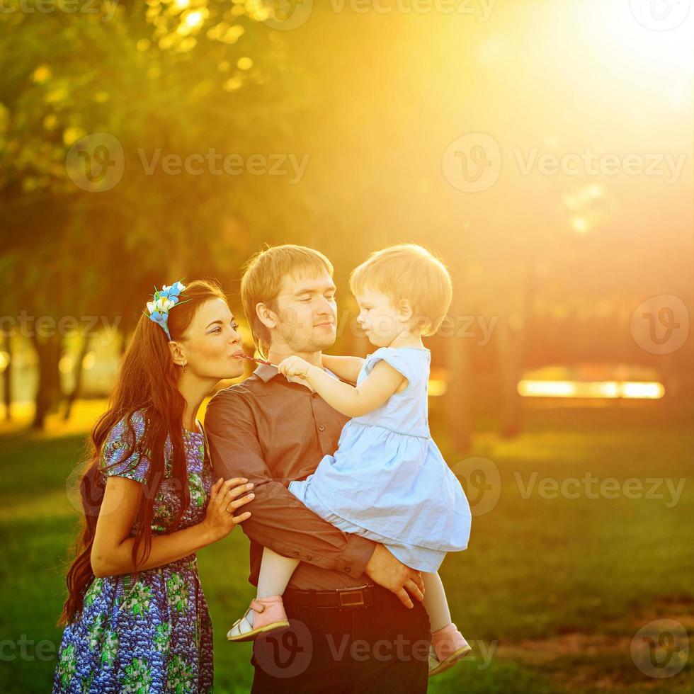 Happy family walking in park photo