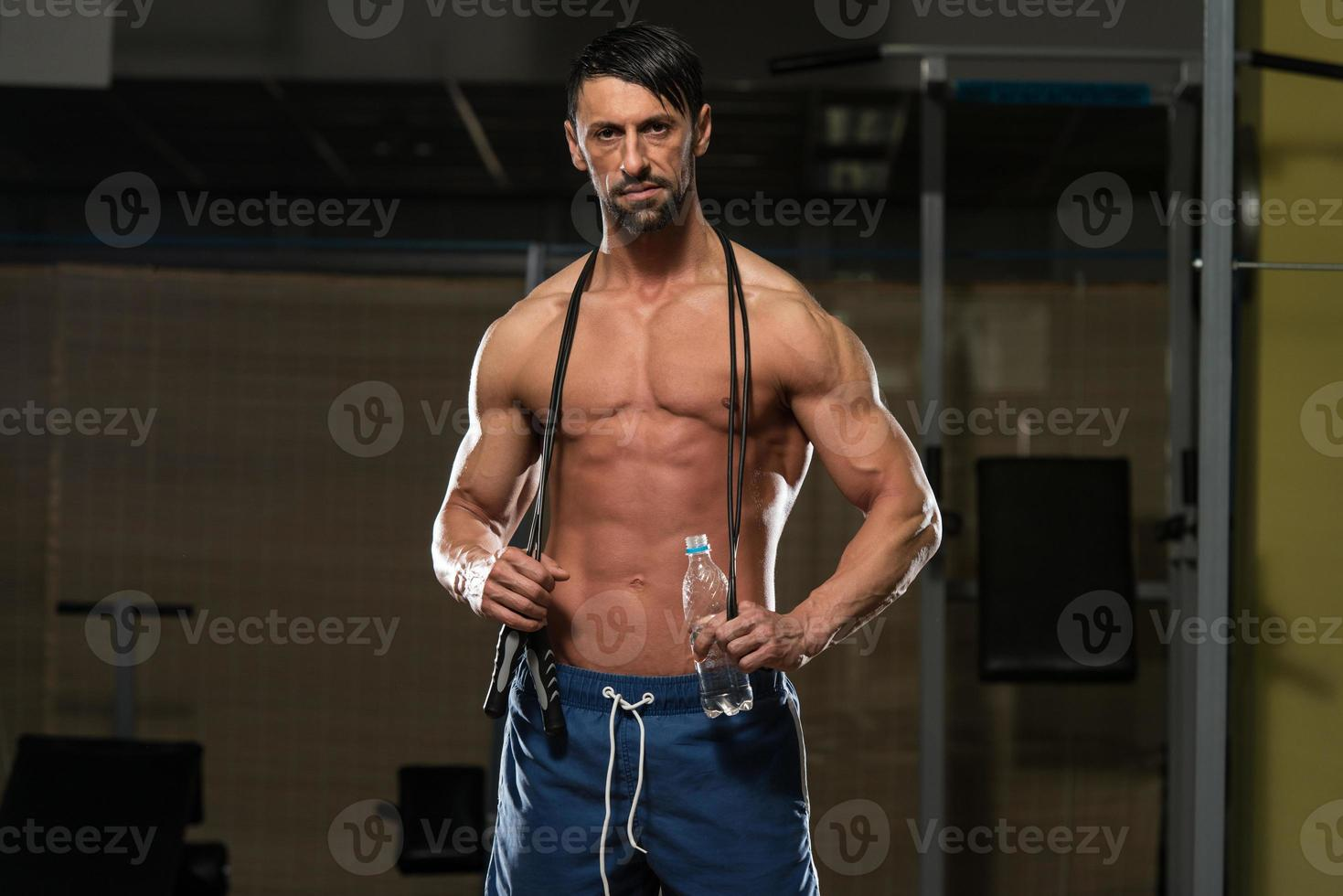 Handsome Muscular Men With Jumping Rope photo