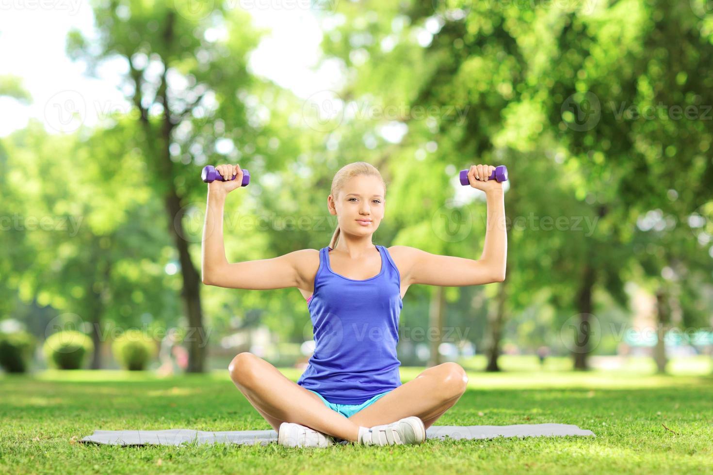 Female exercising with dumbbells photo