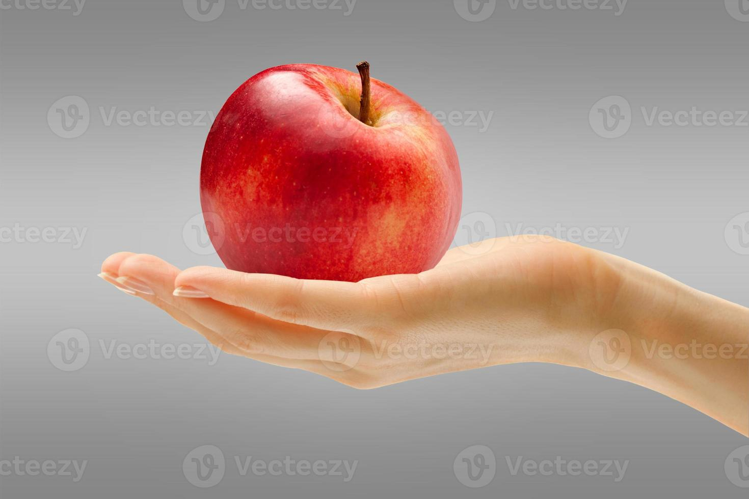 Female hand with red apple photo