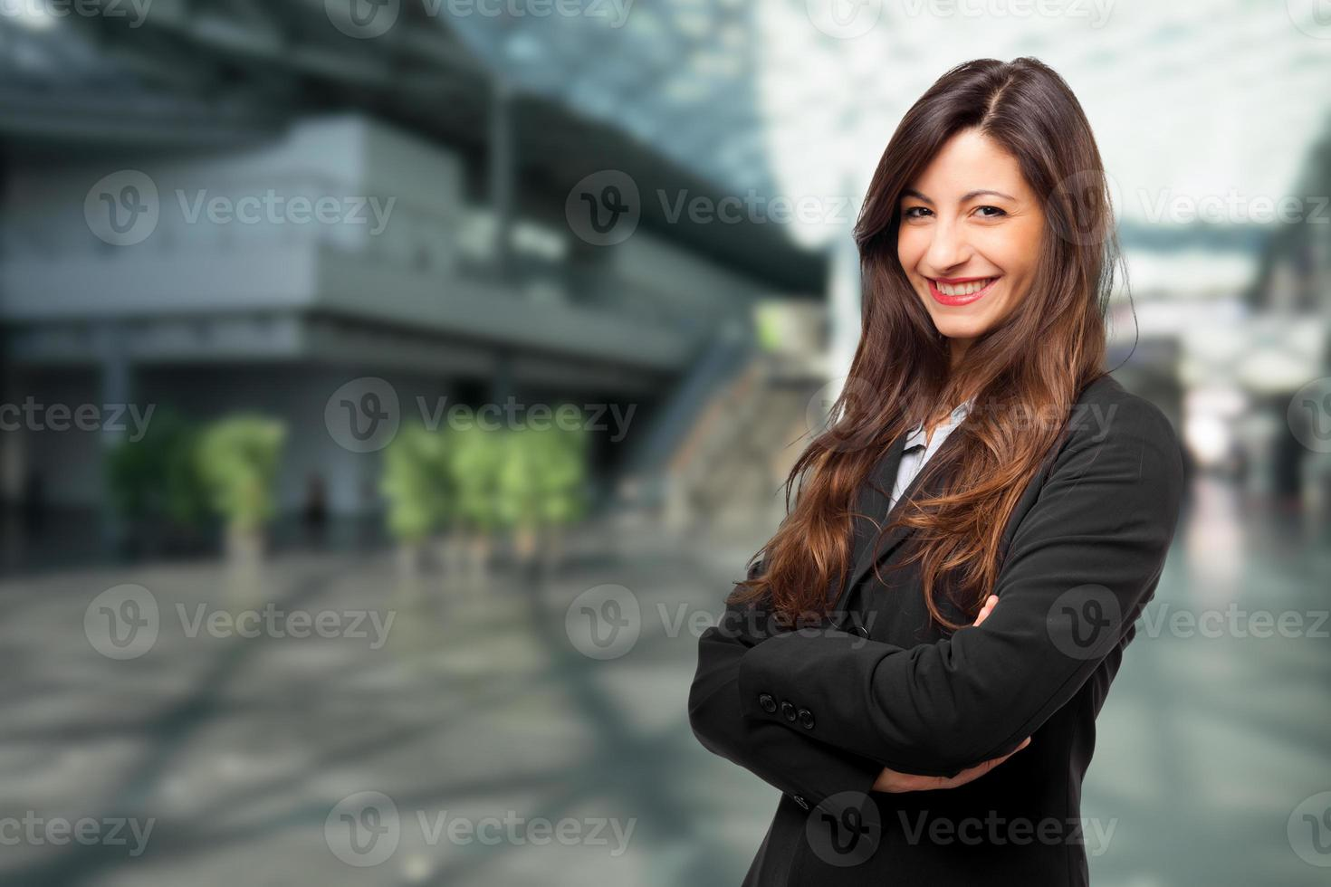 Smiling young female manager portrait photo