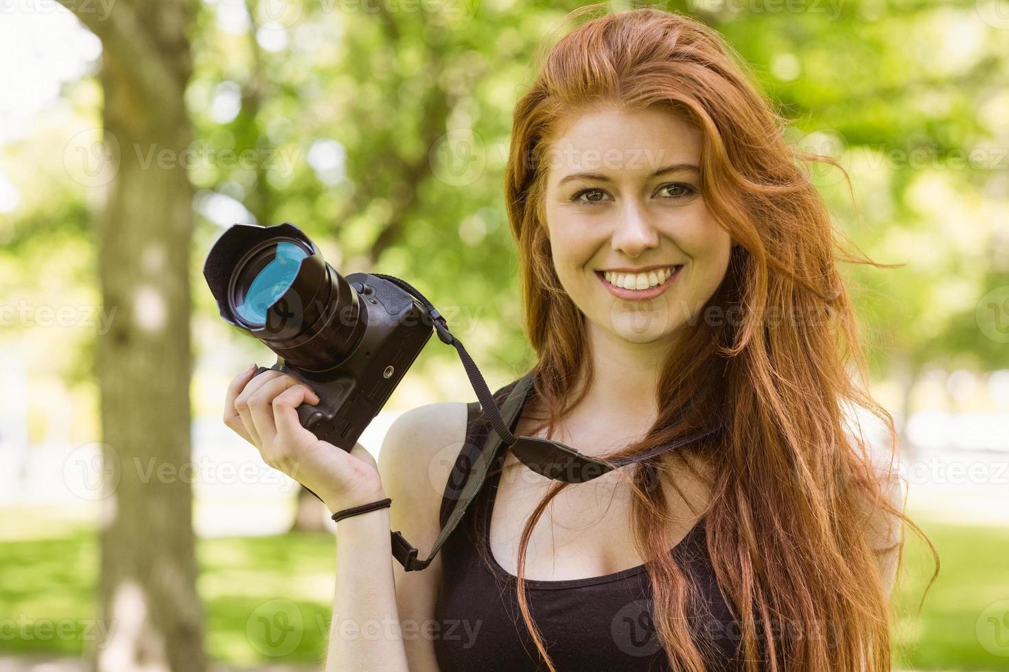 Beautiful female photographer at park photo