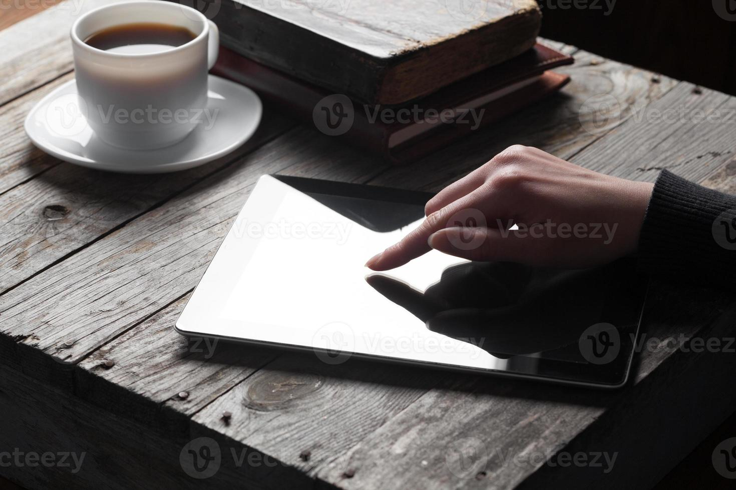Female hand touching digital tablet photo