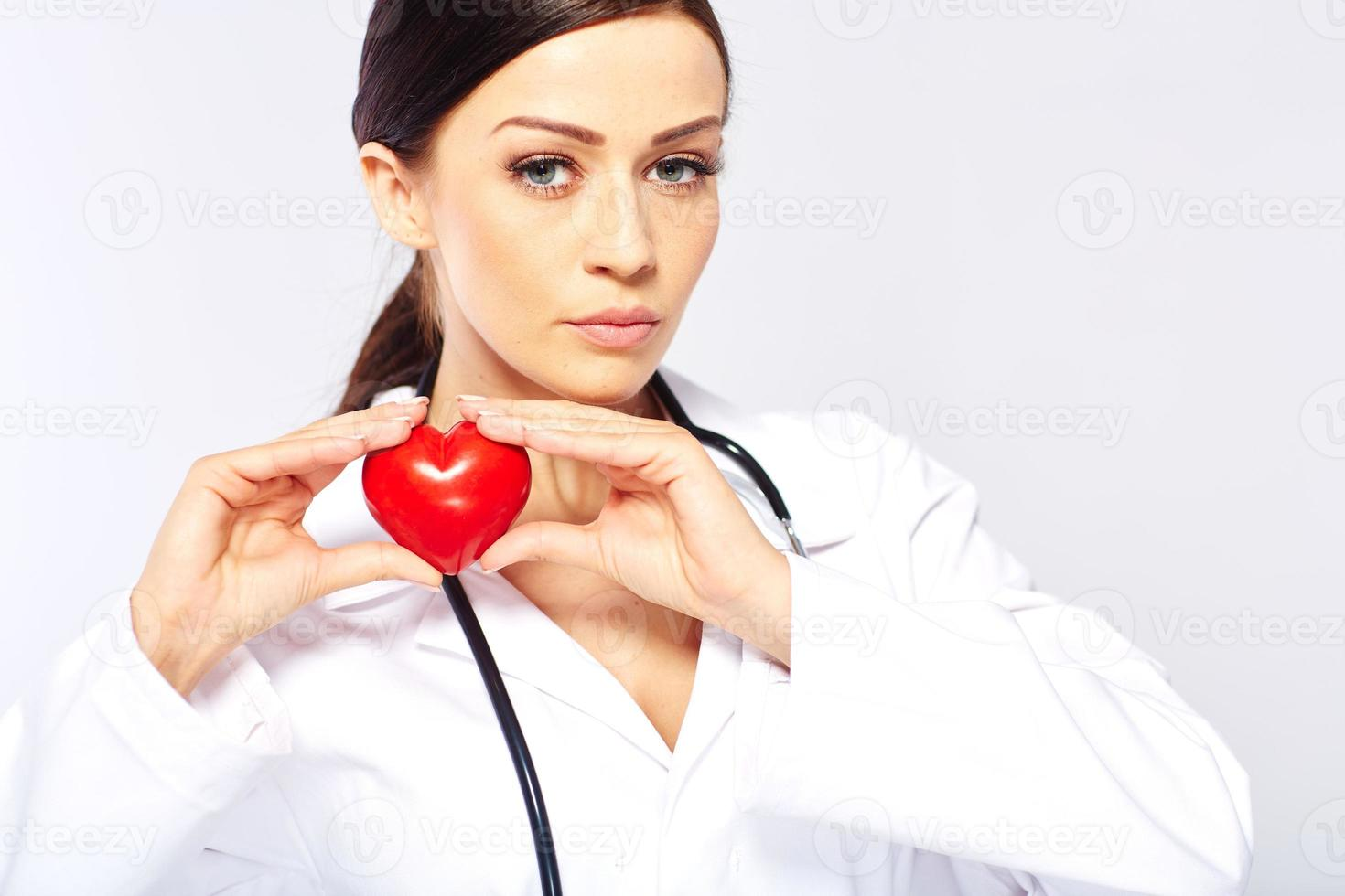 female doctor holding a heart photo