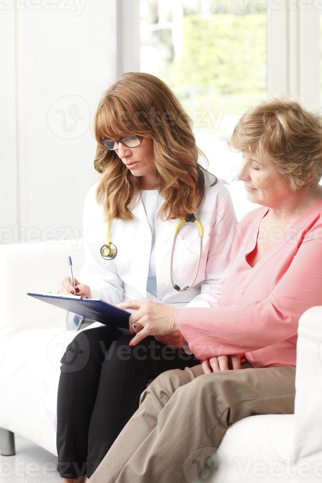 Female doctor with senior patient photo