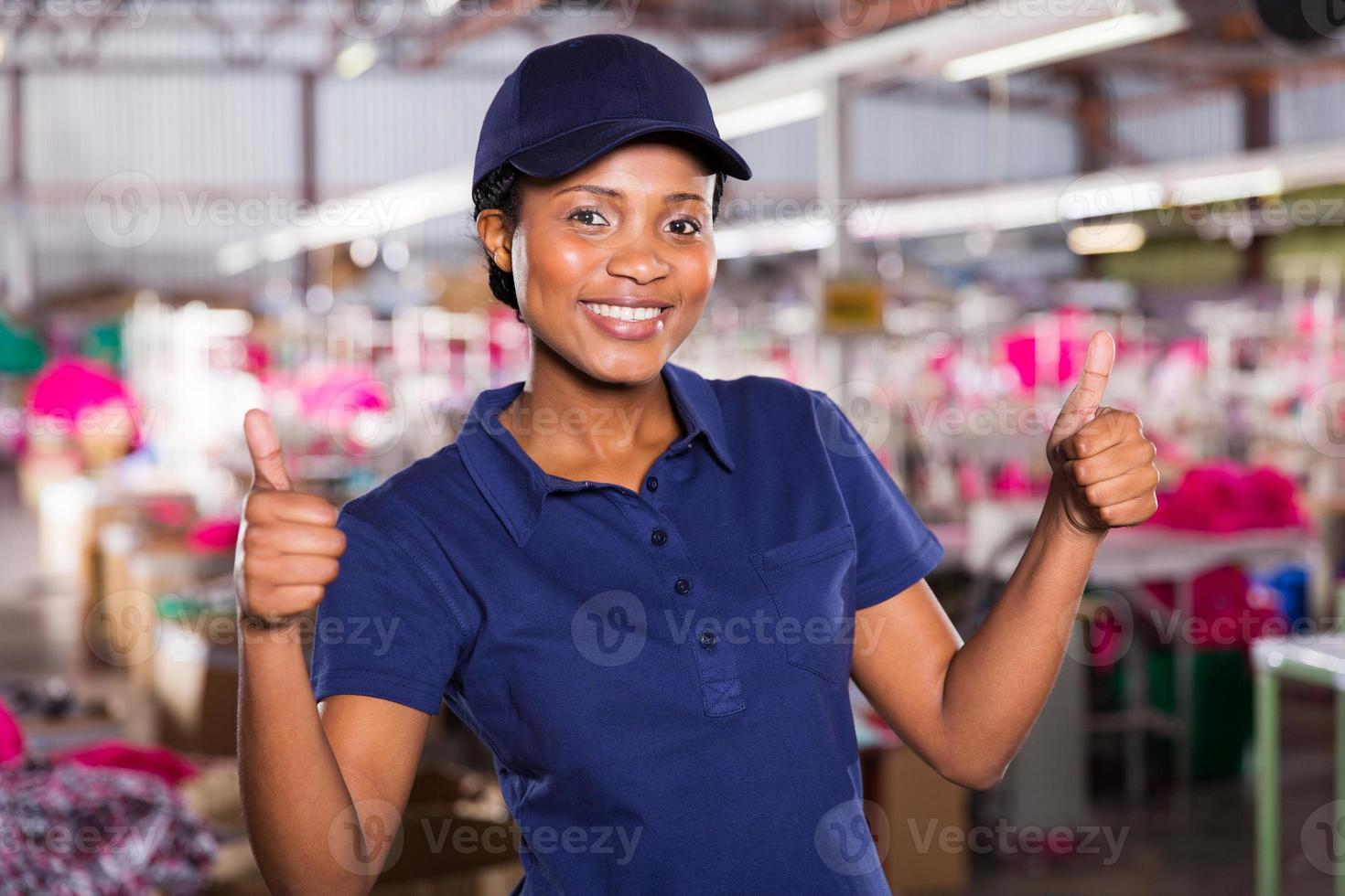 female textile worker with thumbs up photo