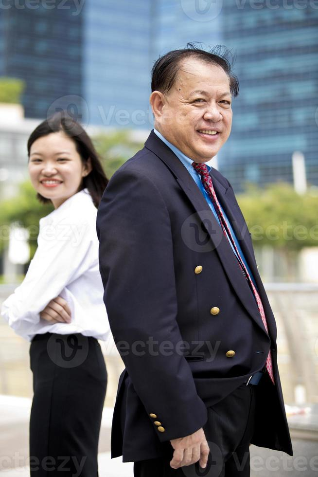 Asian businessman and young female portrait photo