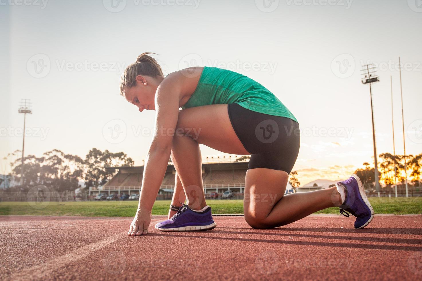 Female runner on an athletics track photo