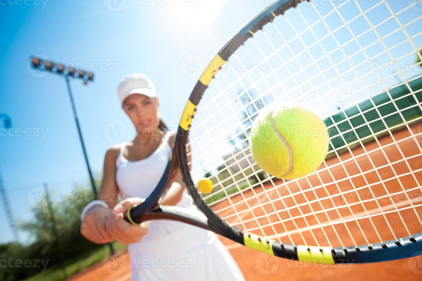 Sporty female tennis player in action photo