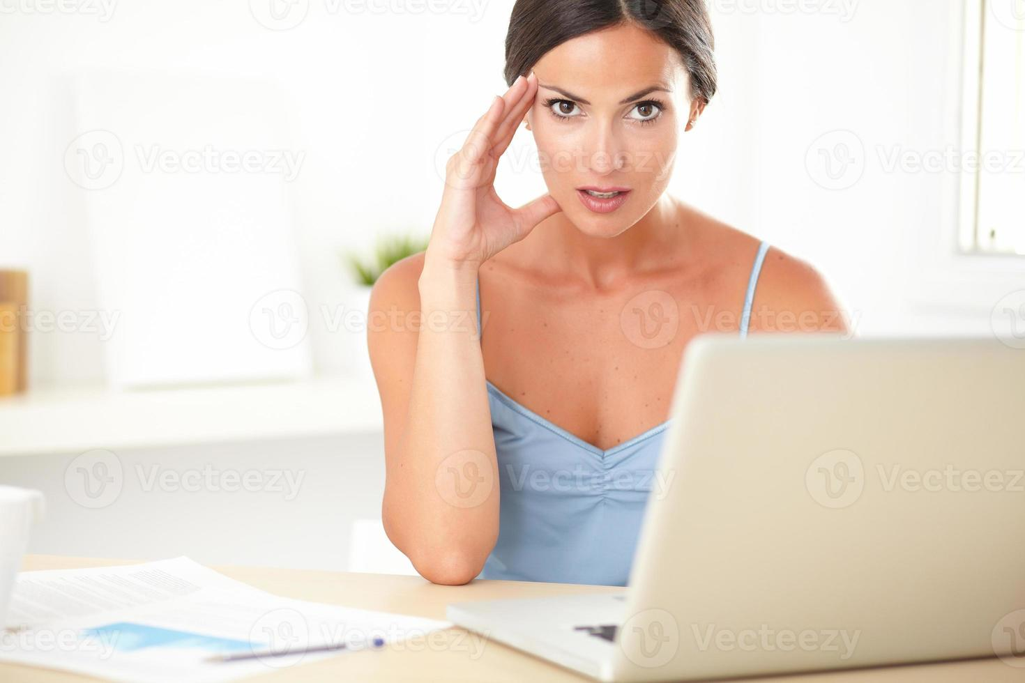 Stylish female feeling tension at work photo