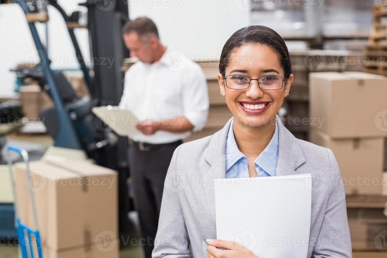 Female manager holding files during busy period photo