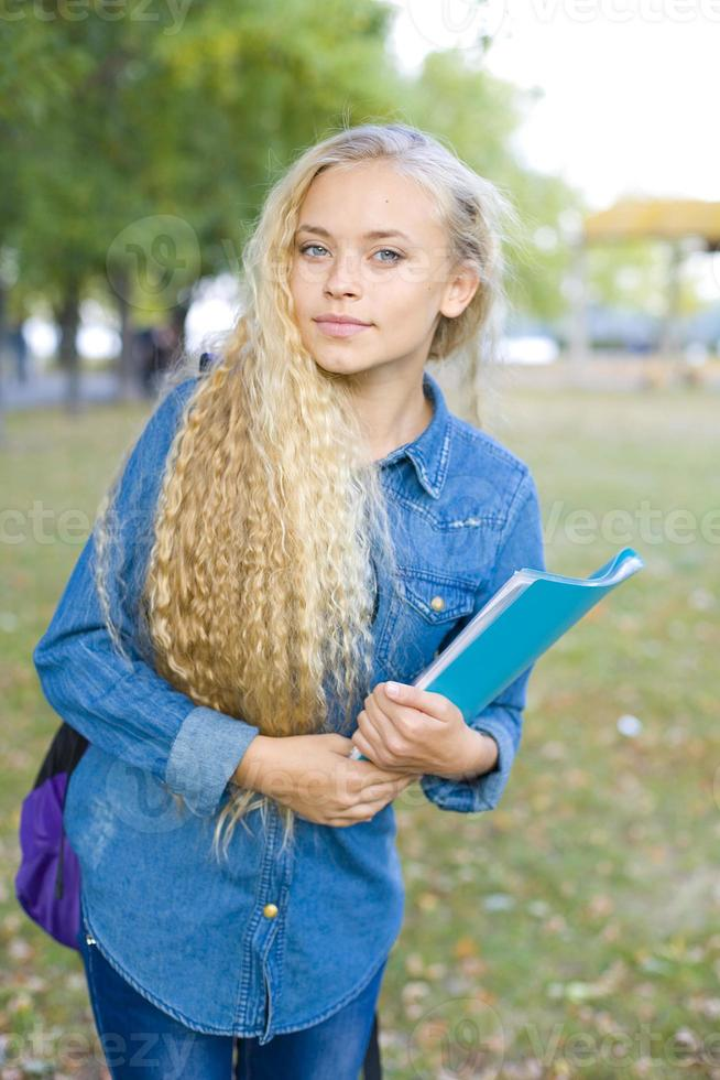 Beautiful young female student in a park photo