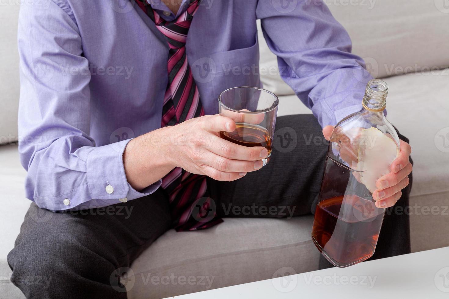 Man drinking brandy photo