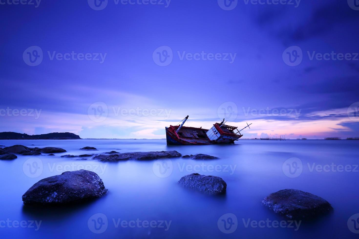 Shipwrecked in sunset photo