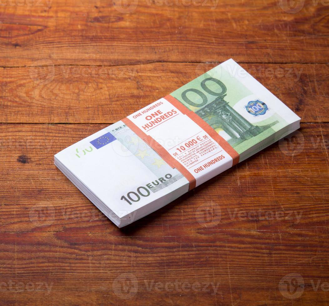 Close-up of  100 Euro banknotes on wood background. photo