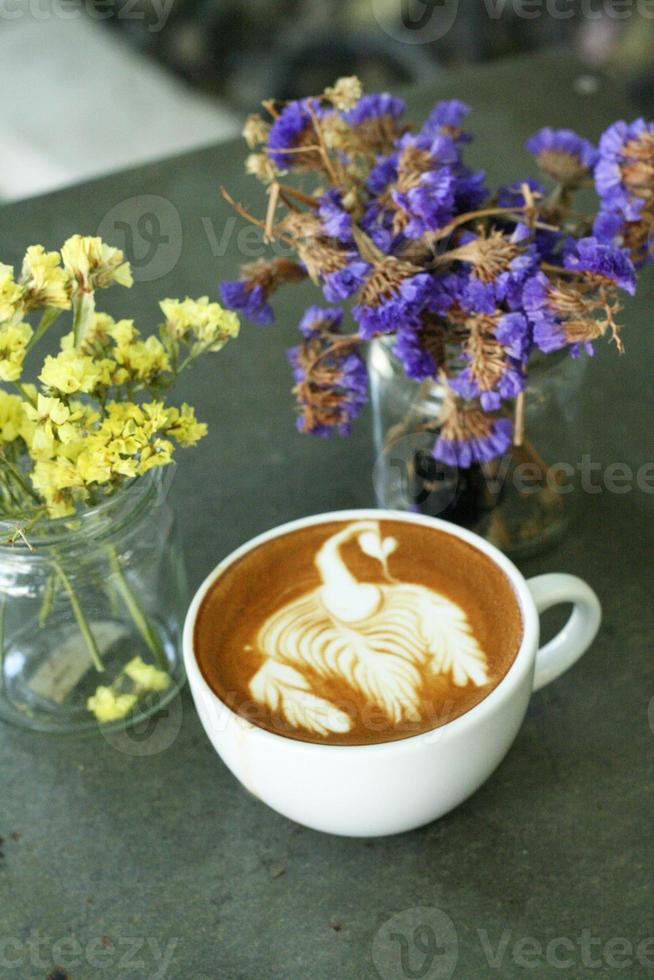 cup of hot latte or cappuccino coffee photo