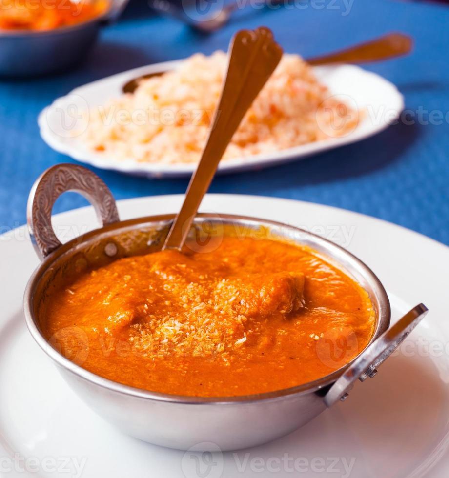 Indian chicken masala metal bowl photo
