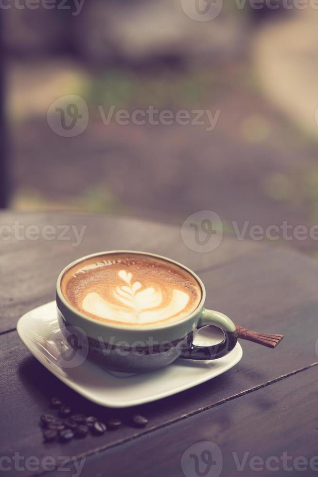 Latte Art coffee with coffee bean vintage color photo