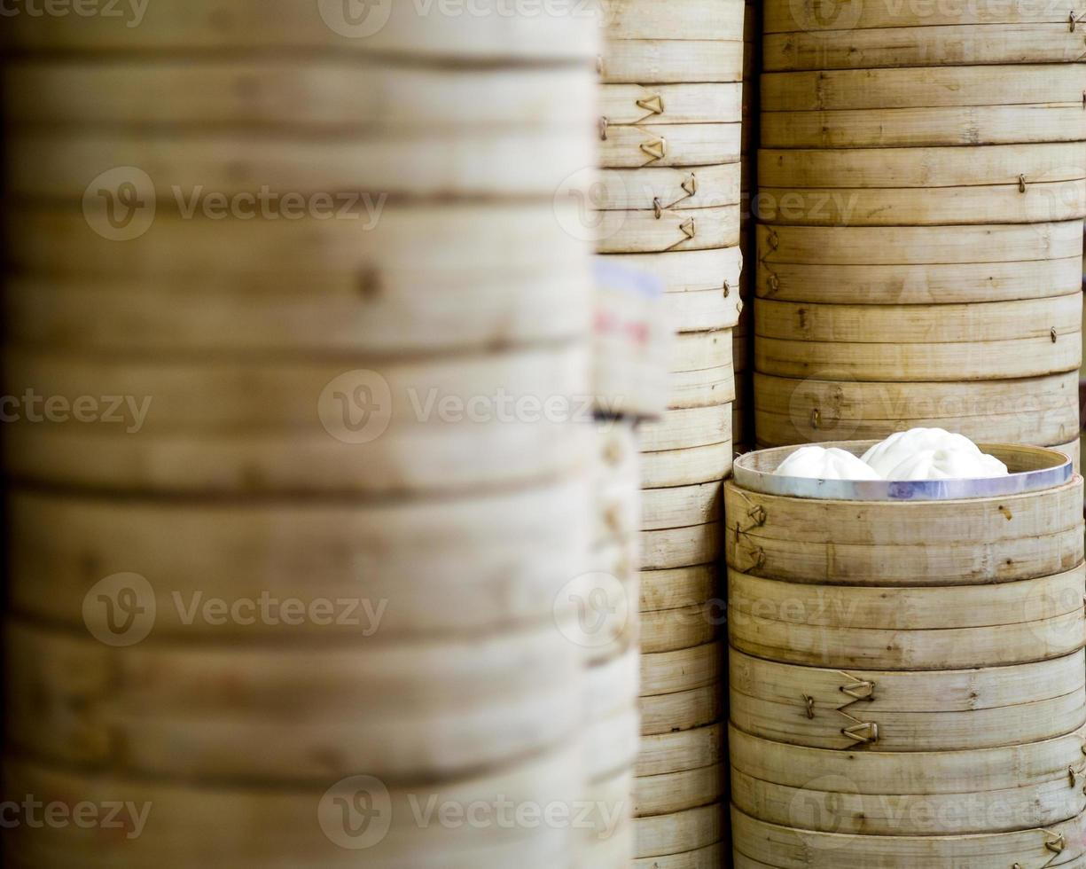 Stack of bamboo rice steamers photo