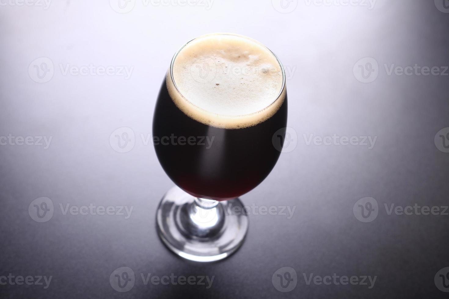 Glass of dark beer photo