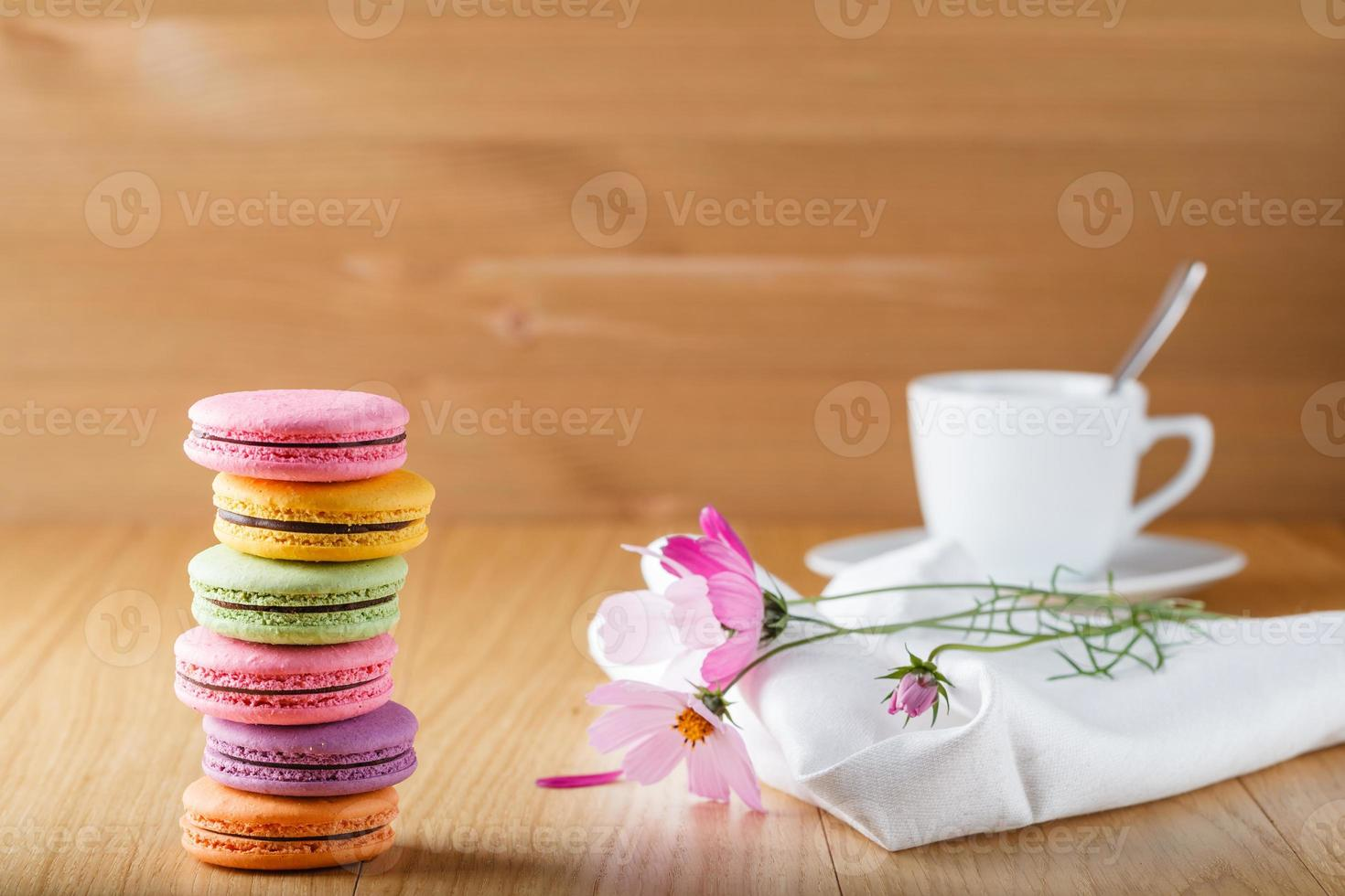 Six colorful french macaron and cup photo