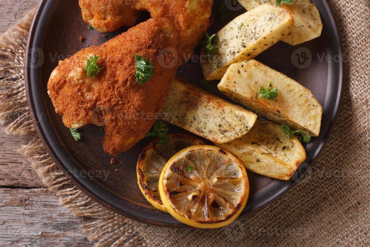 chicken wings in batter closeup with garnish, top view horizonta photo
