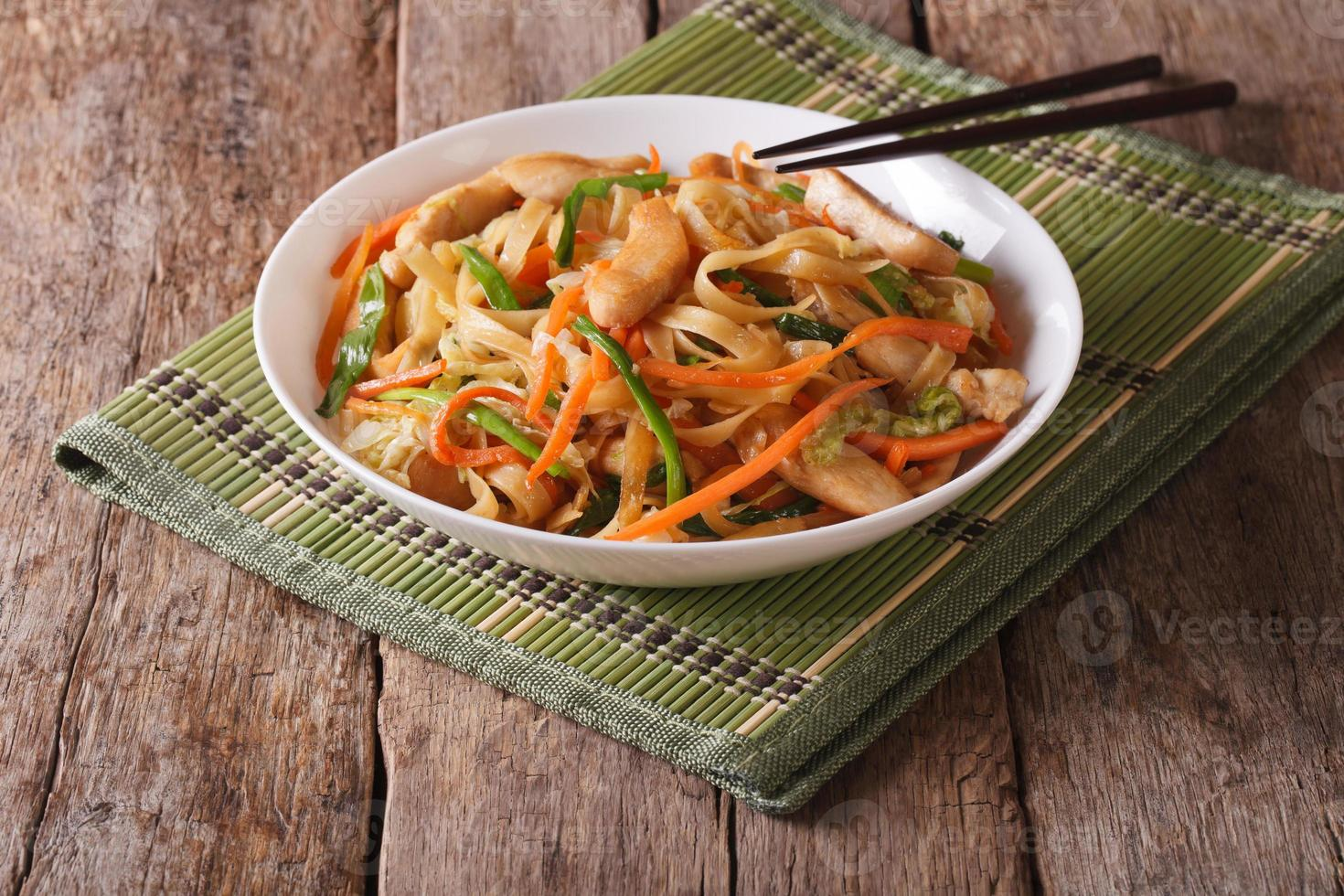 Chow mein with chicken and vegetables, horizontal photo