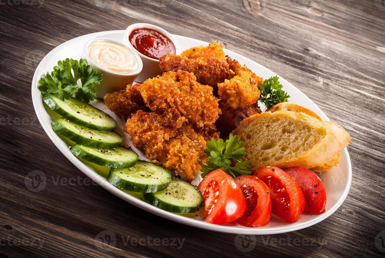 Chicken nuggets and vegetables photo