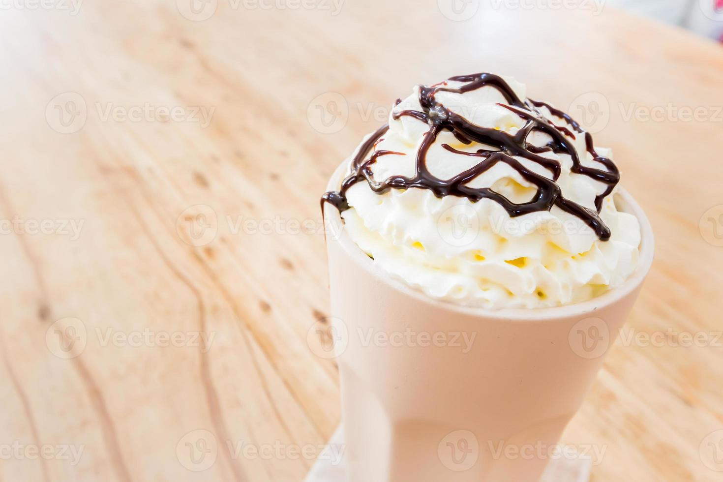 Iced coffee with whipped cream photo