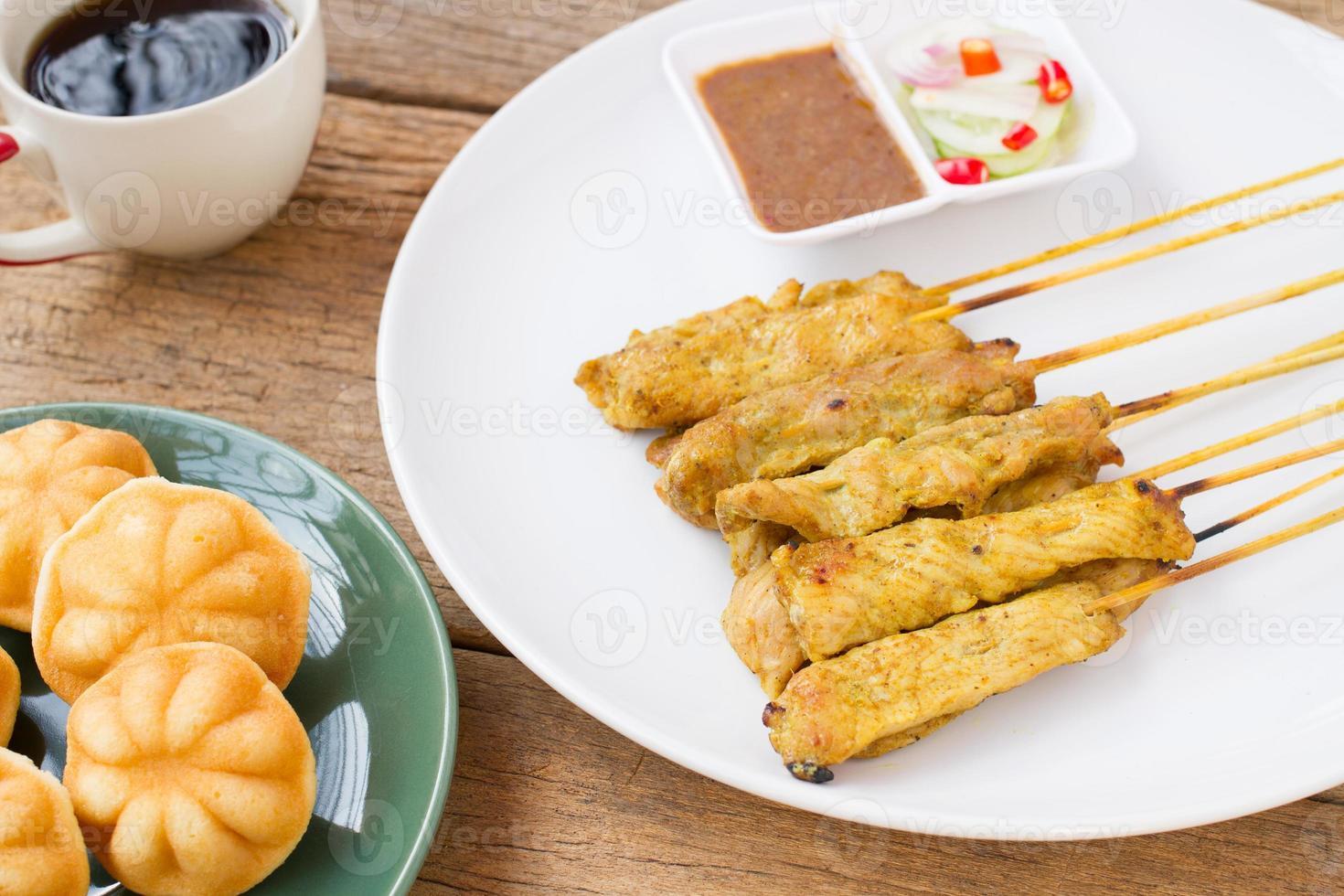 "Thai breakfast ""Pork satay and coffee"" photo"