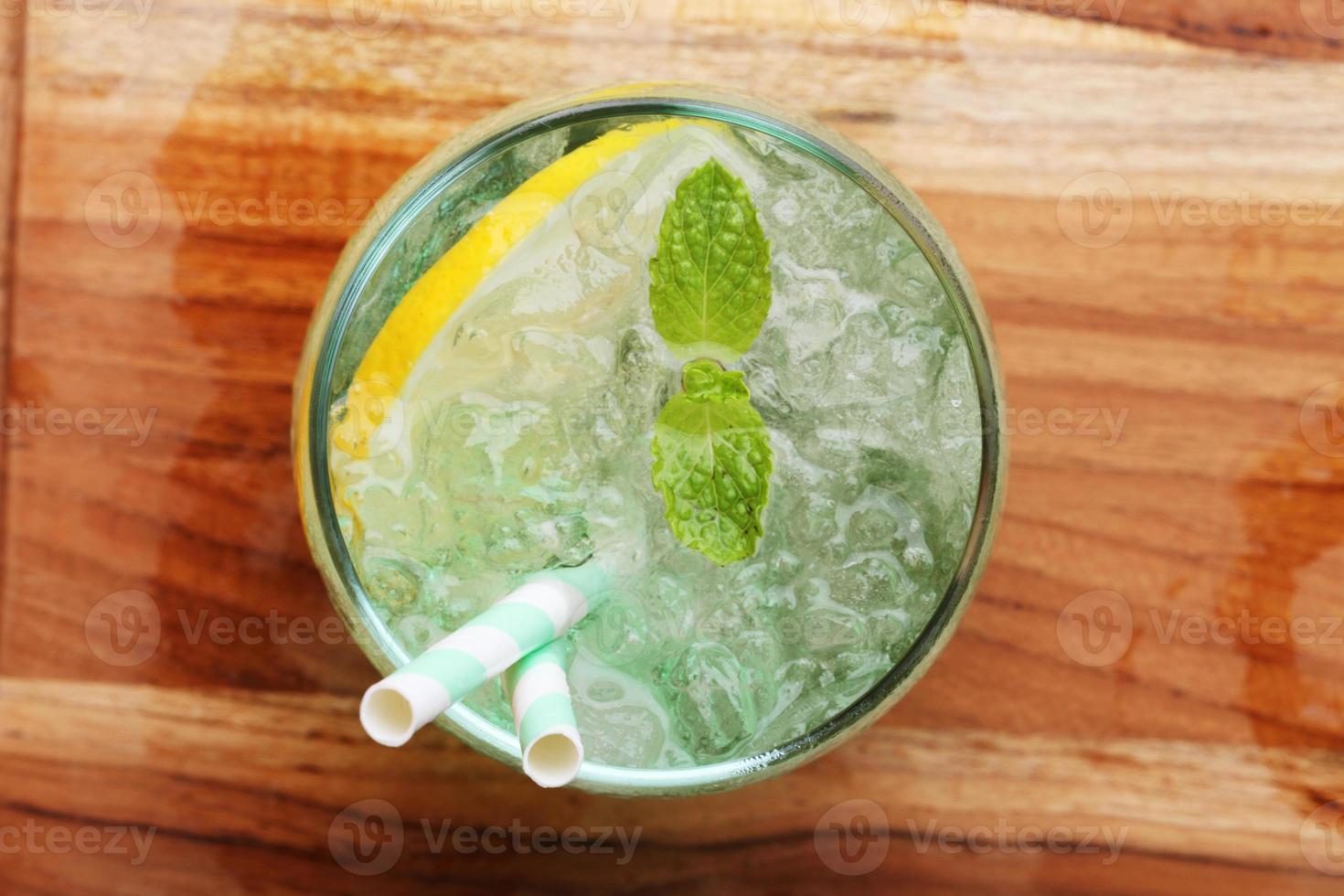 cold soft drink from apple syrup and mint photo