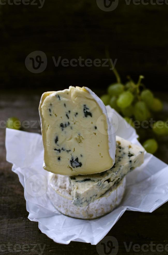 Set of cheese with a white and blue mold photo