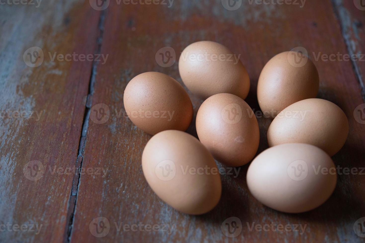 Egg on wood backgrounds photo