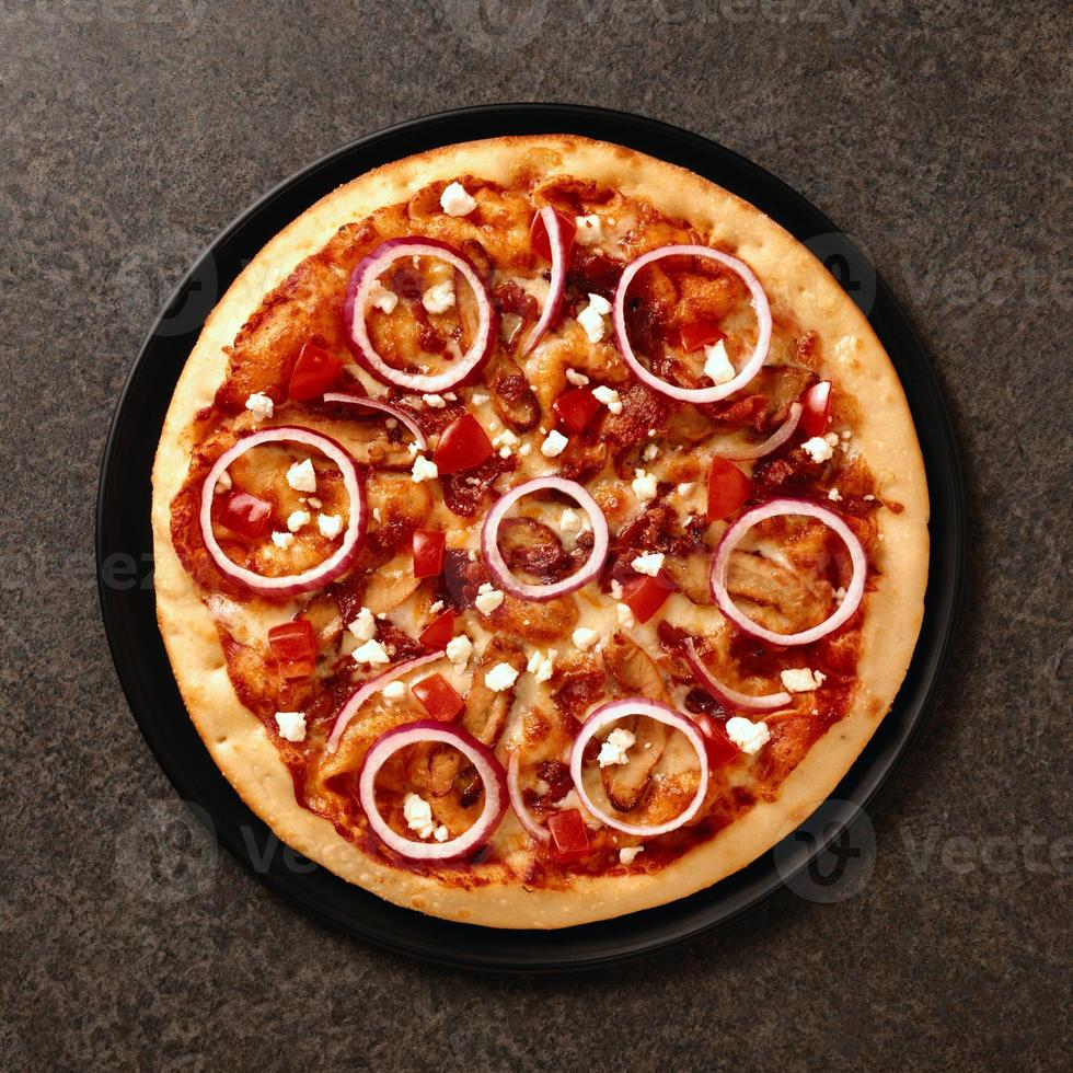 Tasty pizza on stone background photo