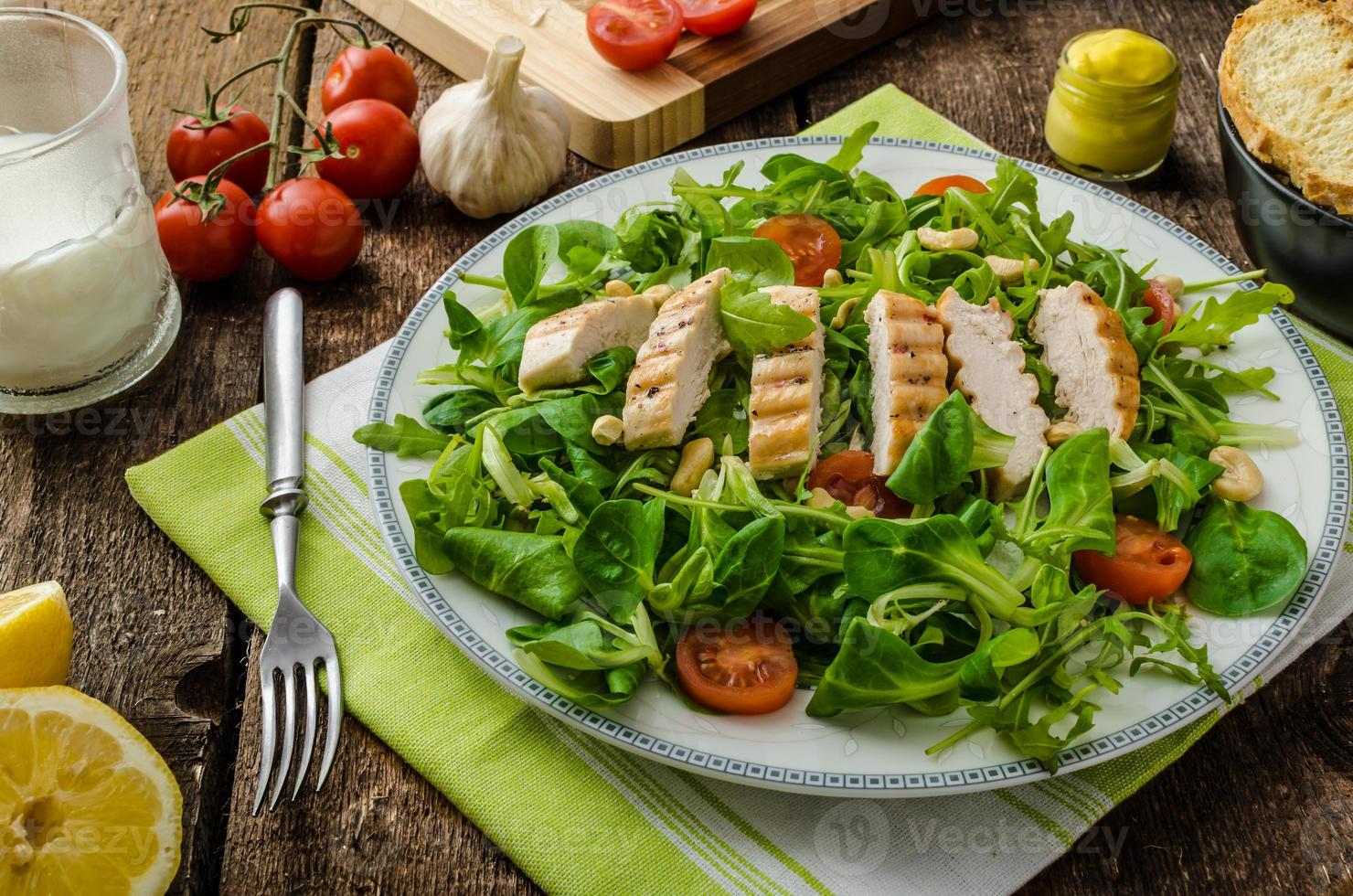 Arugula and lamb's lettuce with grilled chiken photo