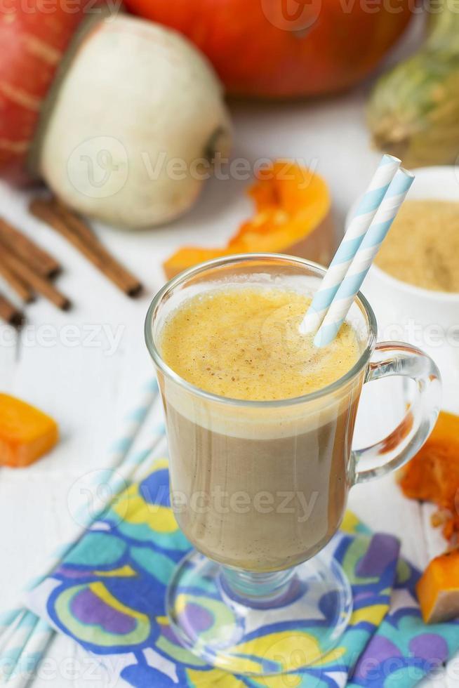 Pumpkin latte - coffee with pumpkin cream and hot drinks. photo