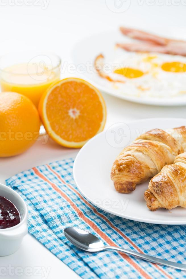 delicious breakfast with croissants and juice photo