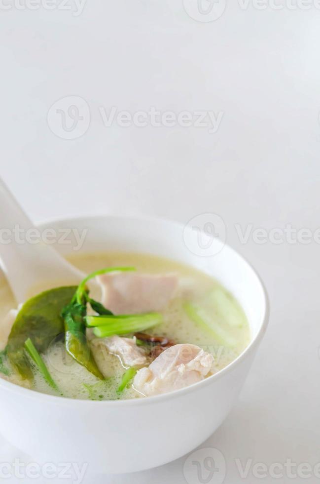 Thai chicken soup in coconut milk photo