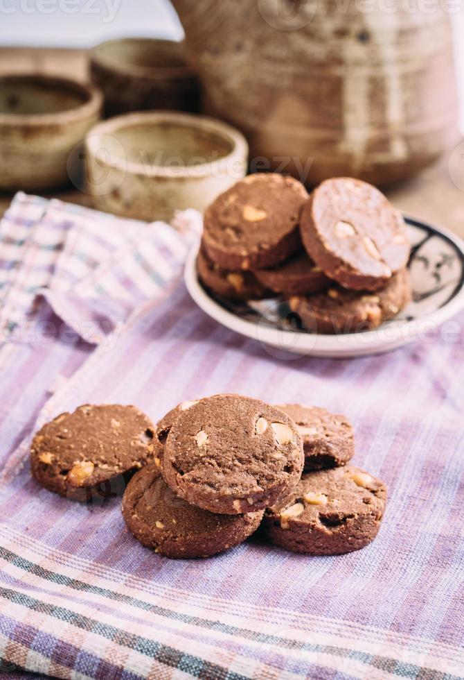 Chocolate and hazelnuts cookies  on cloth photo