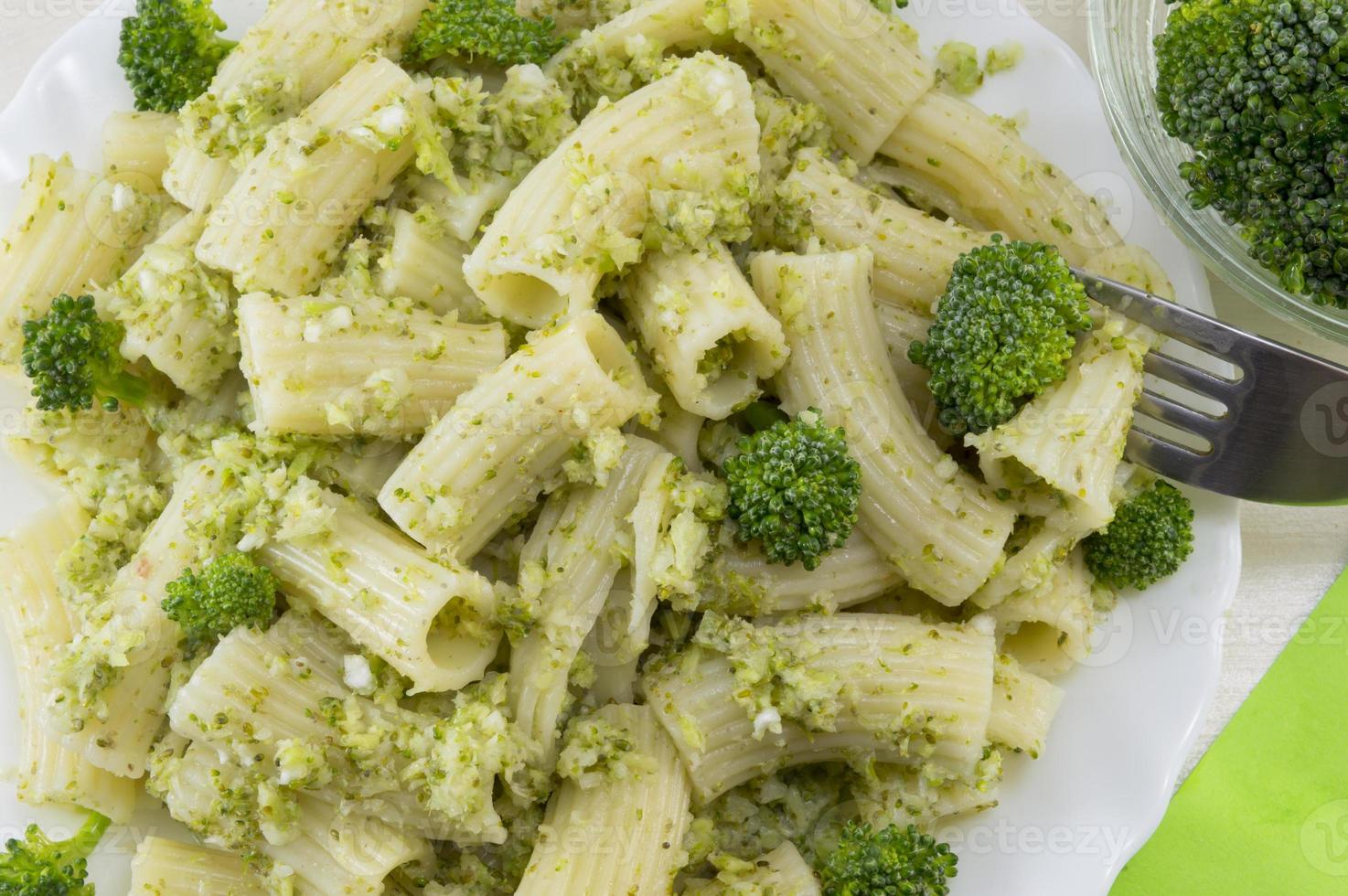 Pasta with broccoli served with cooked broccoli close up photo