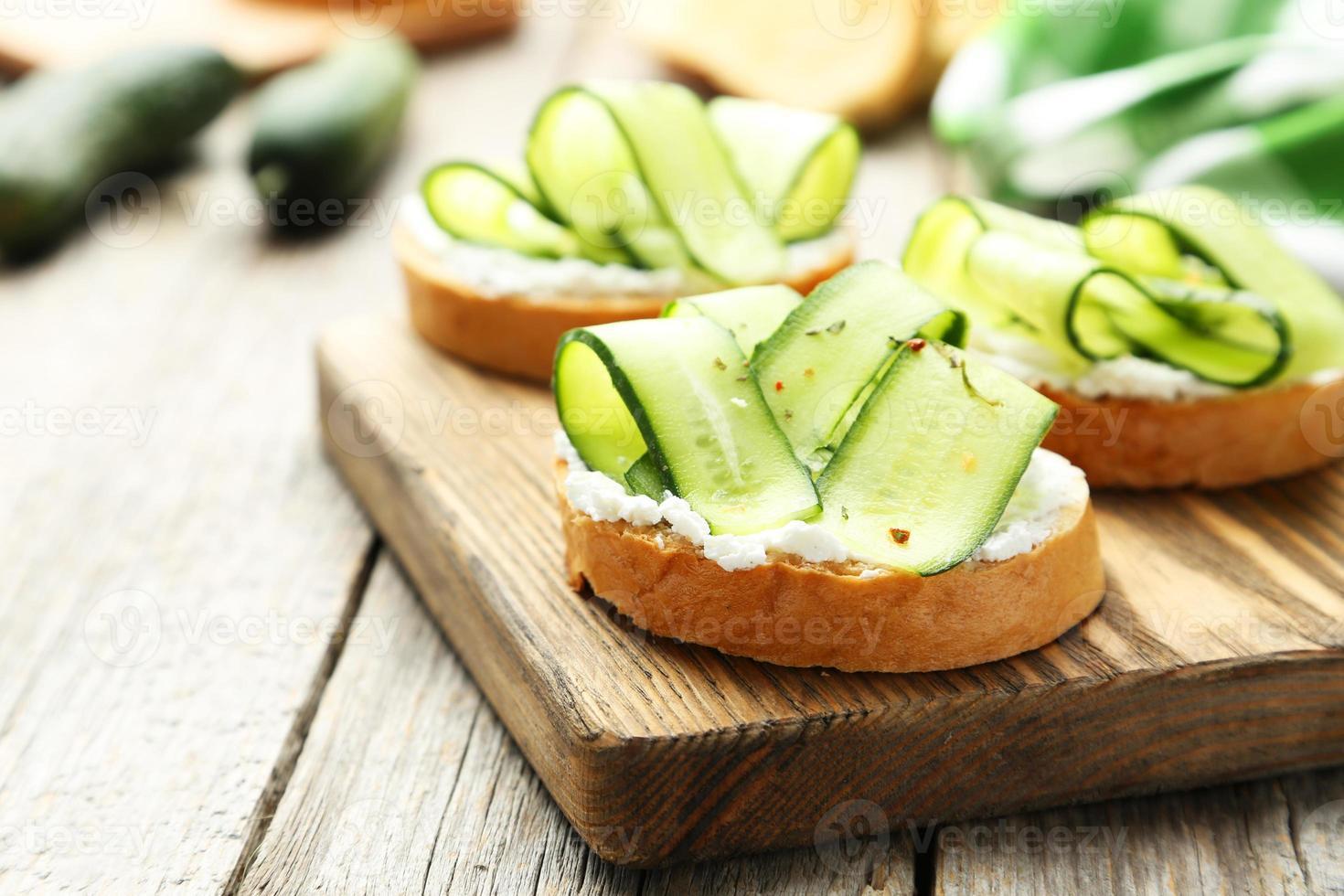 Tasty fresh bruschetta with cucumber photo