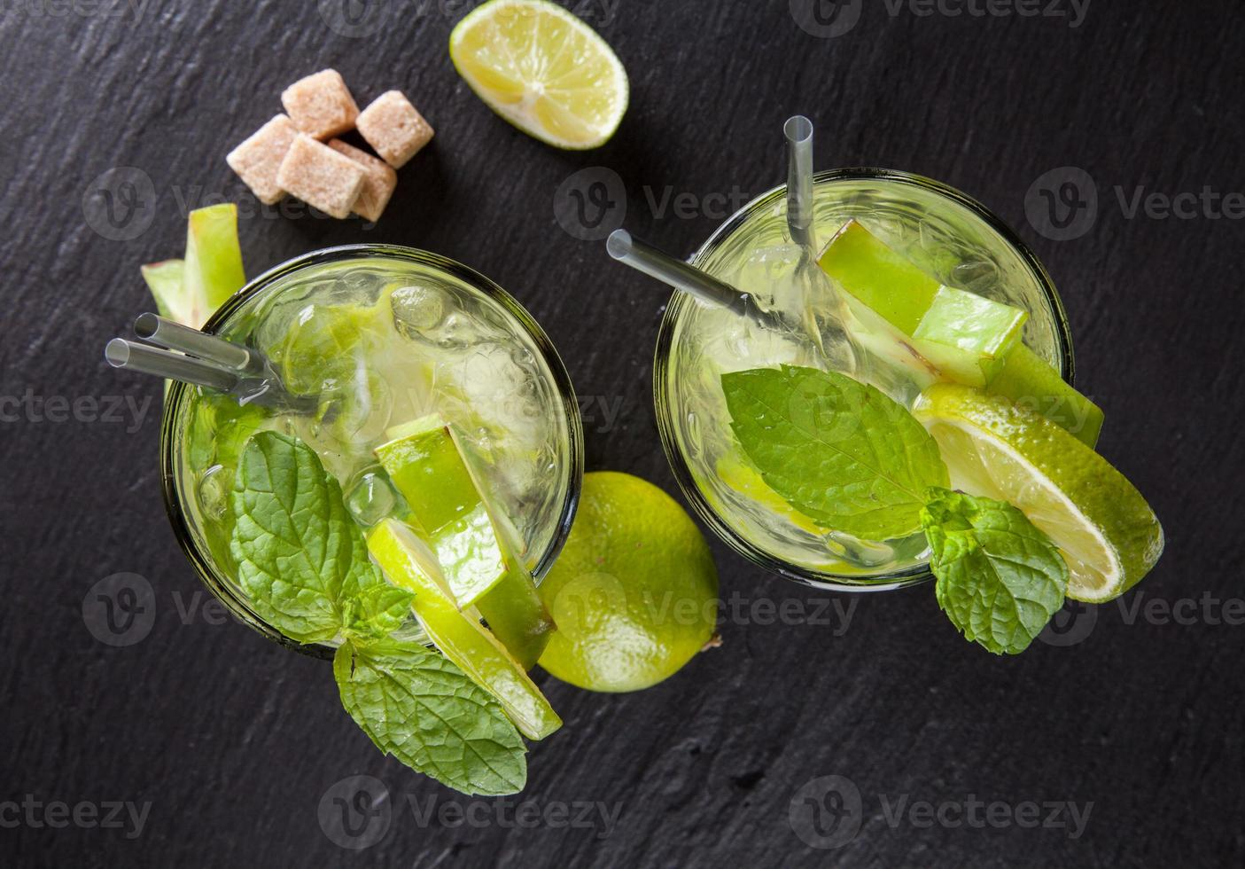 Mojito drinks on stone, upper view photo