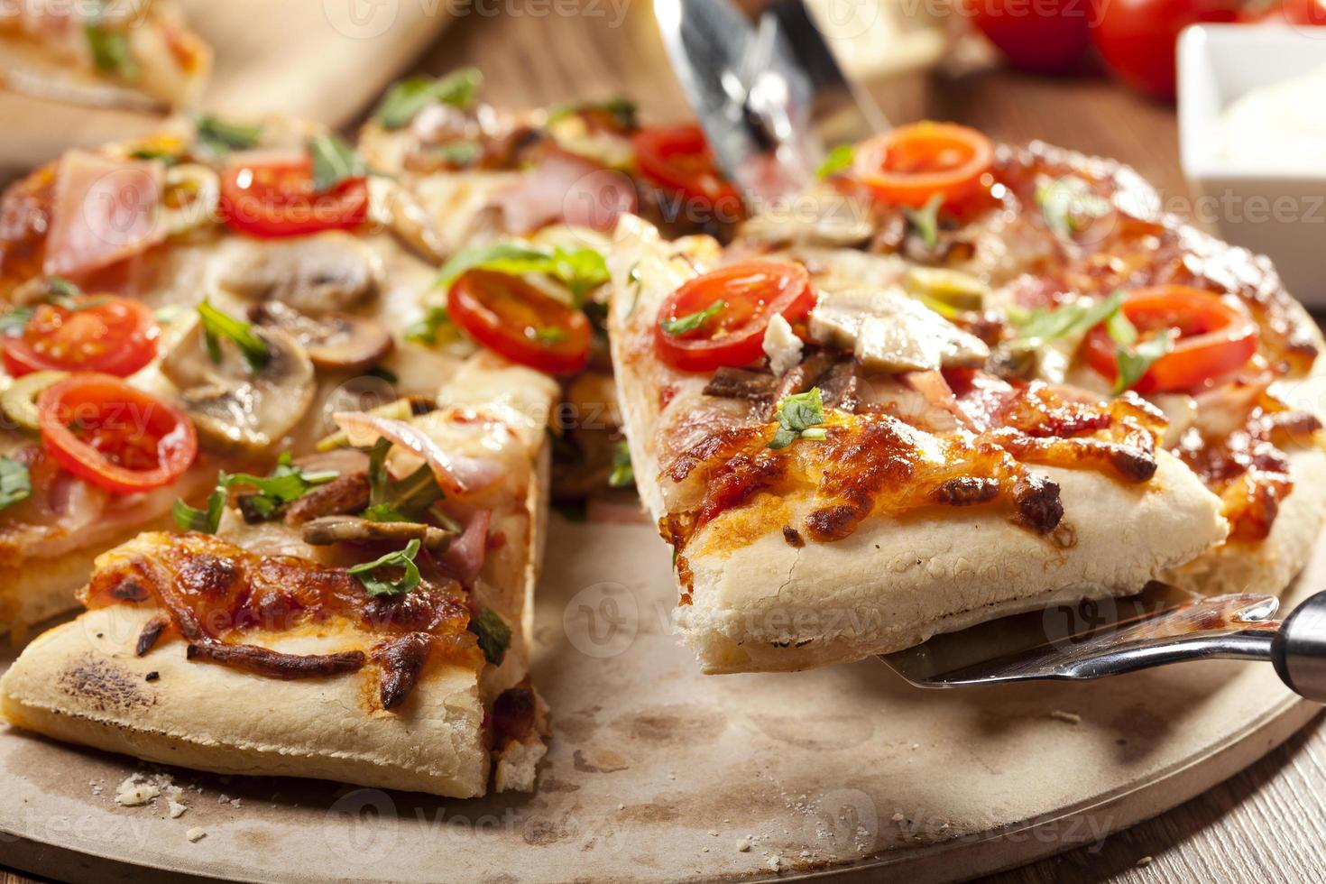 Pizza with ham and mushrooms photo