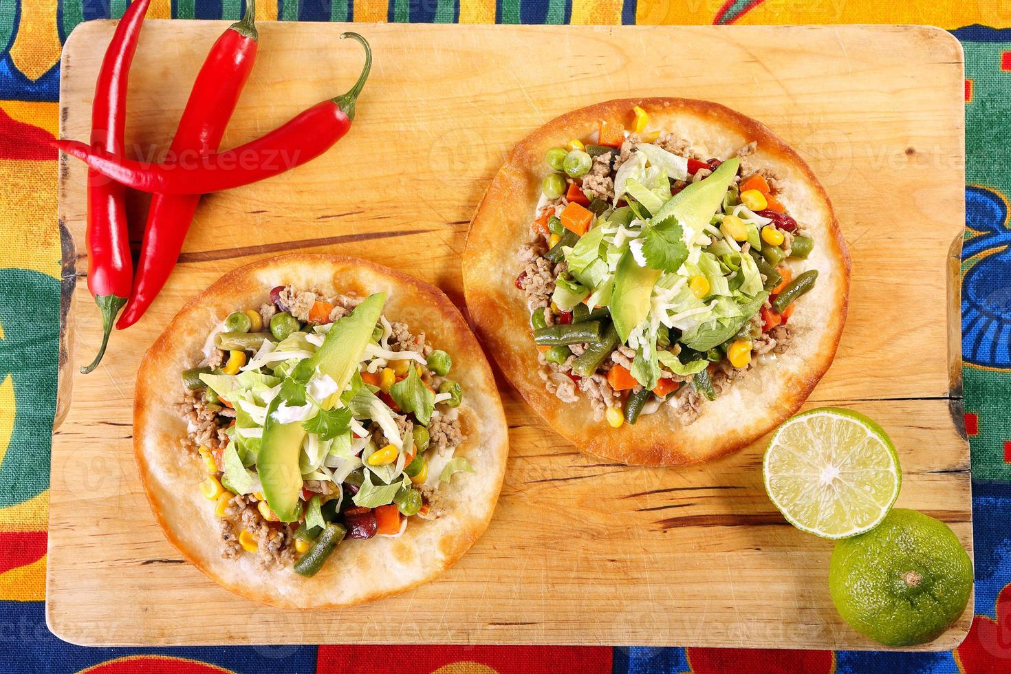 Tostadas with ground beef and vegetables on wooden background photo