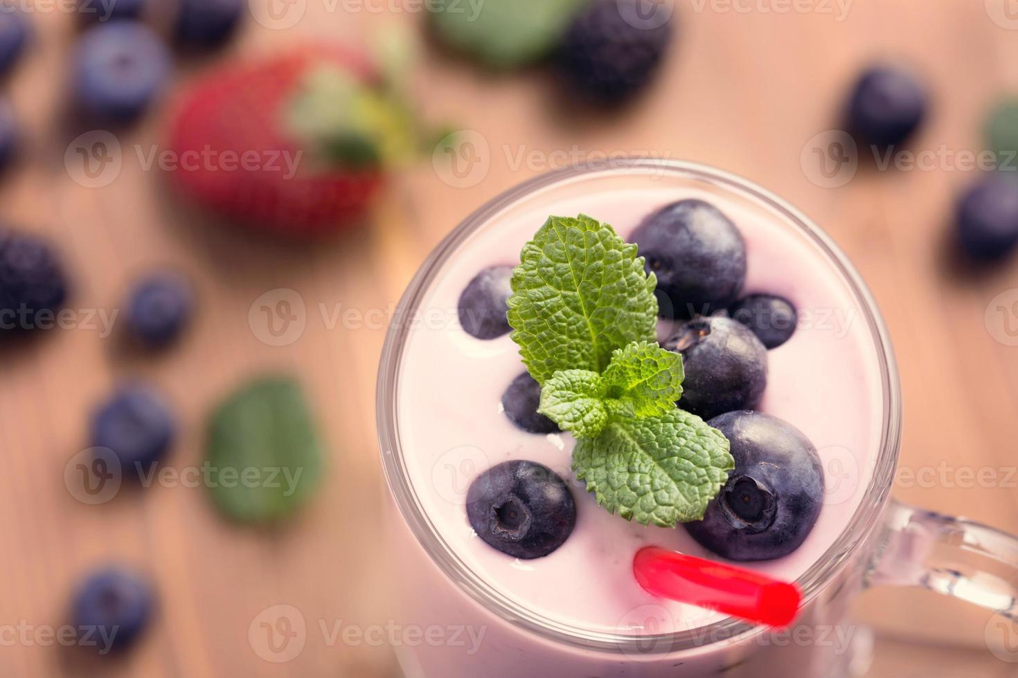 Glass of blueberry smoothie with mint photo