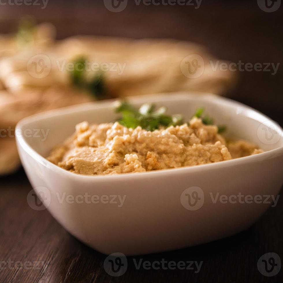 Hummus and pita bread photo